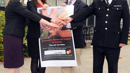 DCI Clare Smith from the harm reduction unit, independent domestic violence advisor Sarah Hill, poli