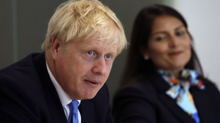 Prime Minister Boris Johnson with Home Secretary Priti Patel. Photograph: Kirsty Wigglewsorth/PA Wir