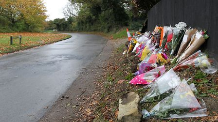 Flowers at the scene of a fatal crash in Weston