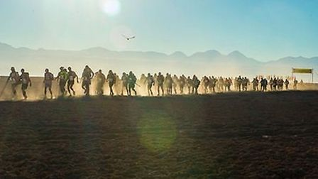Competitors at the start of a stage of the Atacama Crossing race