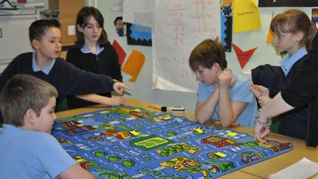 Stonehill School Year 6 students discussing potential noise pollution issues on a fun town layout