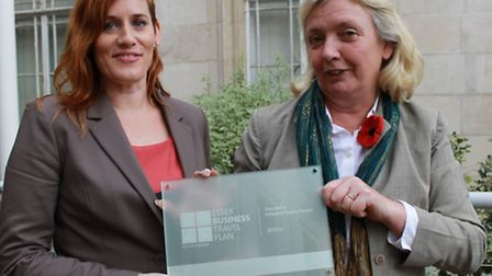 Cllr Susan Barker (right) is presented with the Green Travel Plan Award plaque by Essex County Counc