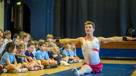 Danny Lawrence shows off his gymnastic skills at Pirton School. Credit: Rafe Abrook Photography.