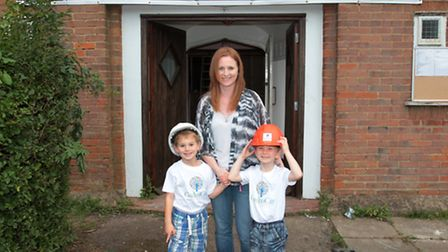 Headteacher Sarah Cummins, with her two sons, Henry Pesci, 6, and Michael Pesci, 4 who will be atten