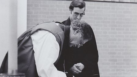 The signing of the agreement between the three faiths in July 1974