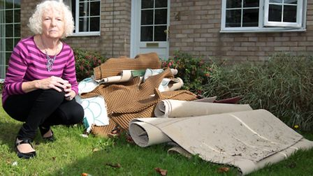 Shirley Edwards outside her flooded home