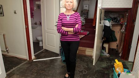 Shirley Edwards in her flooded home