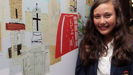 Eloise Cartledge pictured next to some of the hospital artwork