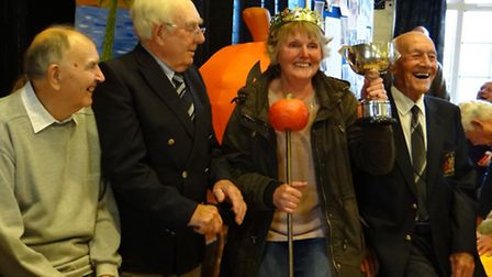 Former champs Fred West, Derek Cook and Bill Saunders flank 2014's Queen Pumpkin, and defending cham