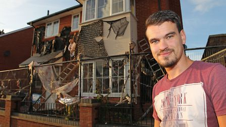 James Creighton stands outside his house on Grove Road which he has decorated for Halloween to raise