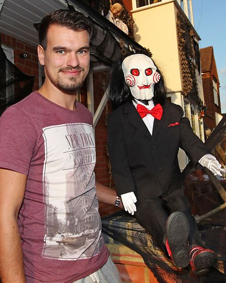 James, pictured with a Jigsaw puppet, has used the Saw films as inspiration this year
