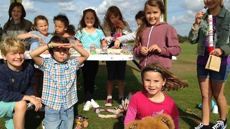 Children heling to raise money on their 'loom band' stall.