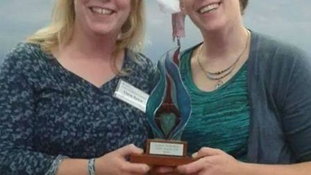 Volunteers Clare Sulch and Liz Marfleet collect a Creative Hertfordshire Flame award on behalf of Rh