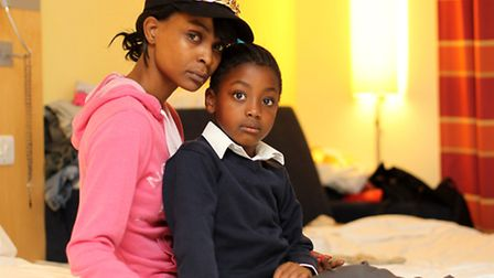 Lucille Wanjiru pictured in the hotel room with her daughter