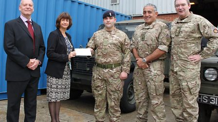 From left, Martin Ford and Gaynor Bradley present the cheque to craftsman Stephen Haverty, who was o