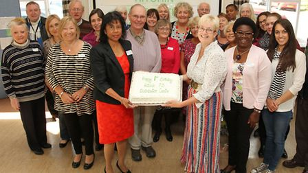 Hitchin distribution centre manager Charmaine Ball celebrates the centre's first birthday with Trish