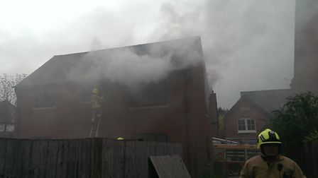 Firefighters tackle the blaze at a flat in Station Street.