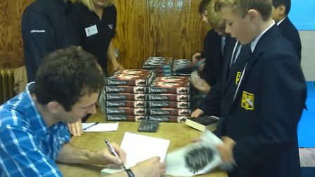 Author Jonathan Stroud visits Hitchin Boys School and signs for Harry Gates