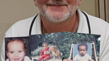 Bruce Harris holds pictures of a young Lewis Hamilton who he and his wife used to look after when he