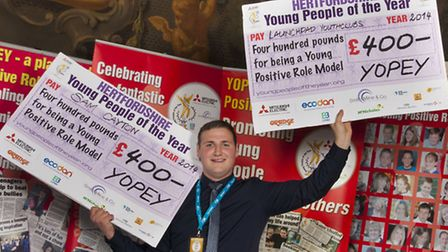 Yopey winner Sam Cayton of Stevenage with prize cheques