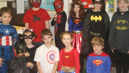 Children from Henlow C of E Academy dressed up as super heros and sold cakes to raise £82.35 for Chi