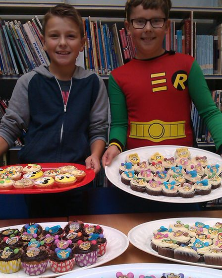 Jack Wilson and Ben Gifford baked over 140 cupcakes with a Pudsey theme and raised £82.35 for Childr