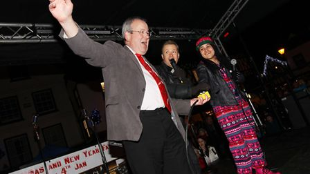 Hitchin Town Centre Manager Keith Hoskins turns on the christmas lights with Stuart Miles and Gabz G