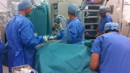 The initial insertion of channels into the patient is the only time the surgeon stands at the table