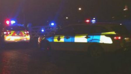 Police at the scene of the Three Moorhens roundabout crash