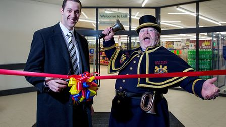 Lidl sales operations manager Nicholas Culverwell opens the store with Letchworth town crier Alan My