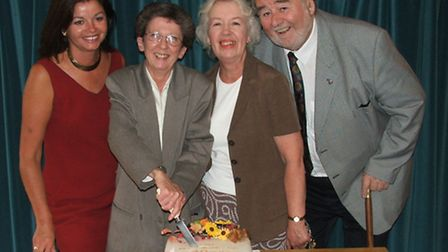 Tributes have been paid to Sue, pictured cutting the cake celebrating 40 years service with Austins