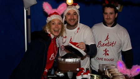 Stallholders get excited at Hitchin's Christmas light switch on. Picture: Geoff Ide.