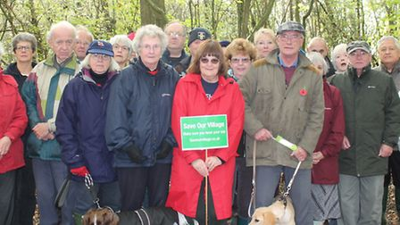 Margaret Shaw (centre) with campaigners to save Alsa wood from development. The wood pictured behind