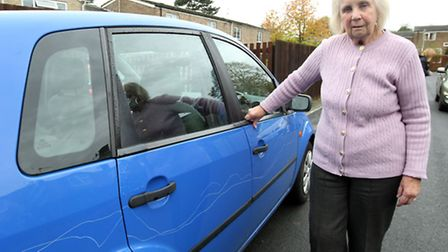 Vera Hensby, 78, with her damaged car