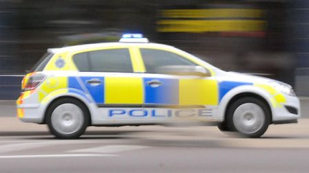 A woman is in a serious condition after she fell out of a moving taxi on Sunday morning.
