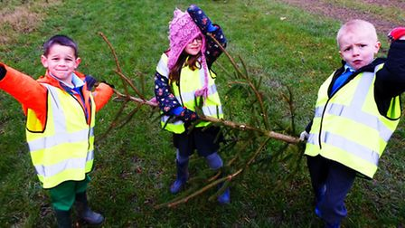 Children from St Paul's Walden Primary School collect their Christmas tree from Whitwell Watercress.