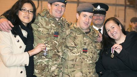 Flying officer Mark Ranstead (centre) showing his medal at the parade