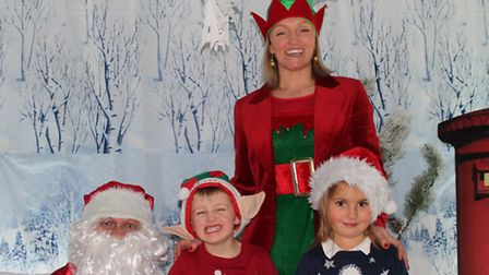 From left, Father Christmas, Little Elf Harry Baines, 5, Helga Hanning and Betty North, 5.