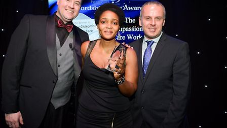 Winner Audrey Chikomba from Meadow Care with HCPA host Wesley Hughes and Ben Livermore of Caring Peo