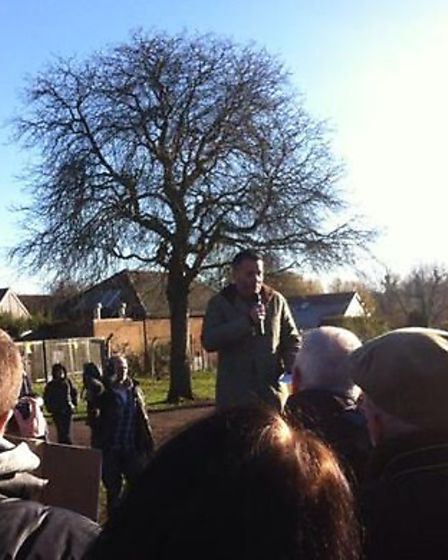 Sky Sports Broadcaster Guillem Balague speaking before the start of the march in Hitchin.