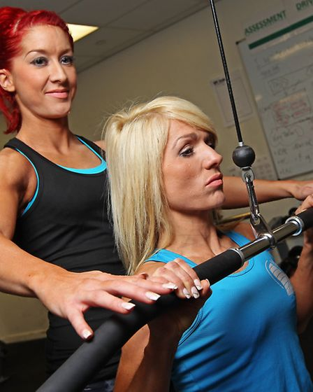 Marriotts School Sports centre duty manager Hannah Jones helps her sister and fitness manager April