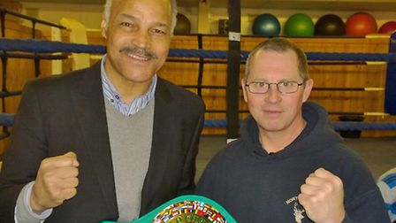 Former World Boxing Champion John Conteh with Wayne Armstrong