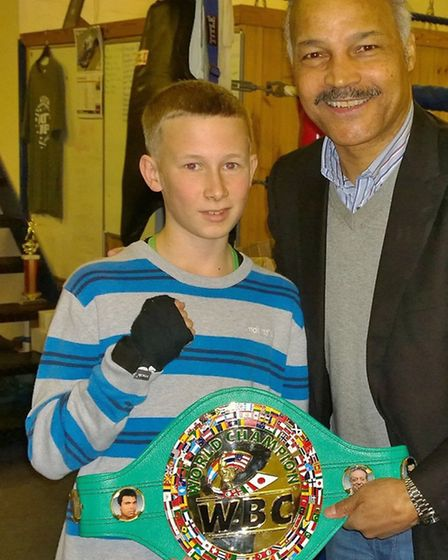 John Conteh with Hitchin's Wayne Armstrong Boxing Gym young boxer Nathan Houghton