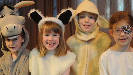 From left, Alfred, Emily, Joel and Natasha play animals visiting the newborn in Ashdon Primary Schoo
