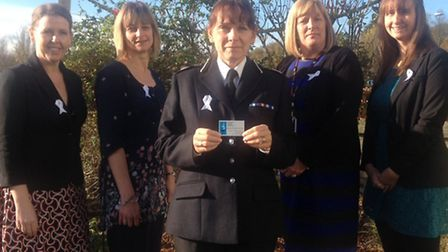 Police wear white ribbons to show support for victims of domestic abuse