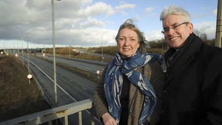 Cllr Susan Barker and Adrian Cannard, Director of Strategy at the LEP, at Junction 8 of the M11.