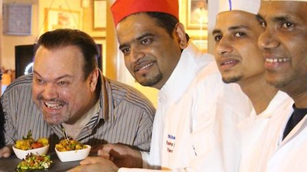 Shaun Williamson of EastEnders fame gets ready to tuck into a curry as chef Oli Khan and fellow staf