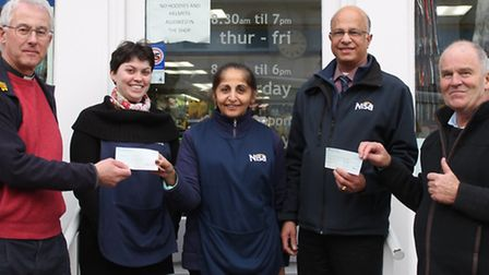 From left, Fr Chris Brown, vicar of Thaxted, Nisa employee Rebecca Fowell, Guildhall Stores Devi Khu