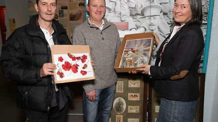 Otto Morrison and Mark Scully from Welwyn House Clearance hand over the first world war memorabilia