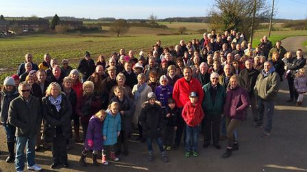 Villagers gather in front of the greenfield site in Walkern which could become housing. Picture: Wal